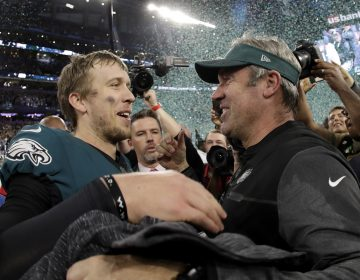 Philadelphia Eagles' Nick Foles celebrates with head coach Doug Pederson after winning Super Bowl LII against the New England Patriots .