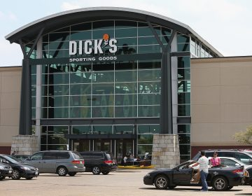 Customers shop at a Dick's Sporting Goods storeinNiles, Ill., in 2014. The sports retailerCEO Ed Stackannounced Dick's is immediately ending its sales of assault-style rifles and requiring all customers to be older than 21 to buy a firearm at its sto