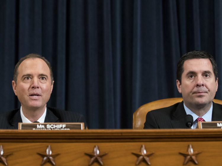 Ranking member Rep. Adam Schiff, D-Calif., questions witnesses as chairman Rep. Devin Nunes, R-Calif., looks on during a House Permanent Select Committee on Intelligence hearing concerning Russian interference in the 2016 presidential election, on Capitol Hill, on March 20, 2017.