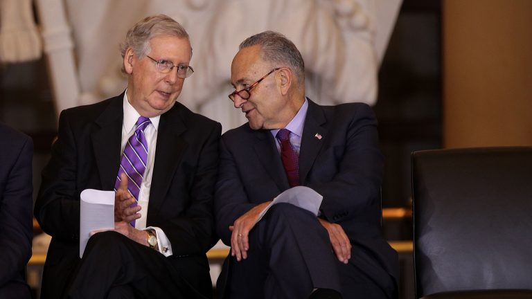 U.S. Senate Majority Leader Sen. Mitch McConnell, R-Ky., (left), chats with Senate Minority Leader Sen. Chuck Schumer, D-NY, (right), at a congressional event in October 2017. (Alex Wong/Getty Images)