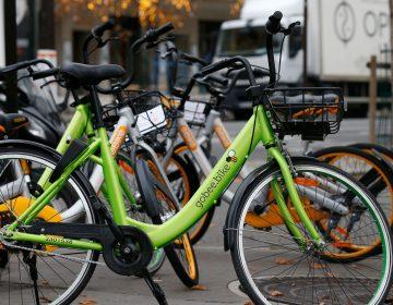 A Gobee bike sits near other bikeshare rental options in Paris on Nov. 18, 2017. (Geoffroy Van Der Hasselt/AFP/Getty Images)
