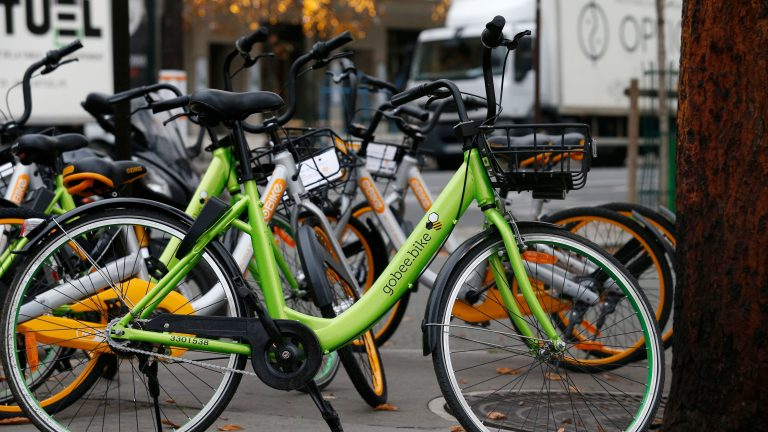 A Gobee bike sits near other bikeshare rental options in Paris on Nov. 18, 2017. (Geoffroy Van Der Hasselt/AFP/Getty Images)