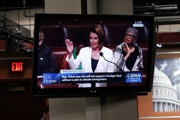 A TV in the Capitol shows House Minority Leader Nancy Pelosi, D-Calif., giving a speech on the House floor Wednesday. Pelosi has been speaking for more than seven hours as a protest because negotiations over the future of the expiring Deferred Action for Childhood Arrivals program have stalled.