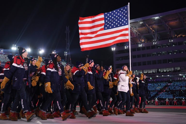 The United States team walks in the Parade of Athletes during the Winter Olympics opening ceremony on Friday. The team has more athletes than any nation at the Games and it's the most diverse of any U.S. winter squad, in terms of both race and gender. There are 108 women on the team, more than any other U.S. Winter Olympics team in the past.