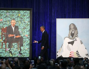 Former U.S. President Barack Obama stands with his and former first lady Michelle Obama's newly unveiled portrait during a ceremony at the Smithsonian's National Portrait Gallery (Mark Wilson/Getty Images)