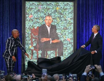 Former President Barack Obama (right) and artist Kehinde Wiley unveil his portrait during a ceremony at the Smithsonian's National Portrait Gallery. (Mark Wilson/Getty Images)