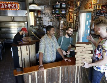 In this Wednesday, Sept. 12, 2012 photo, the owners of Pizza Brain, from left, Joseph Hunter, Michael Carter, Ryan Anderson, and Brian Dwyer work the storefront in Philadelphia. Hundreds of people turned out for the grand opening of Pizza Brain this month in Philadelphia's Fishtown neighborhood.