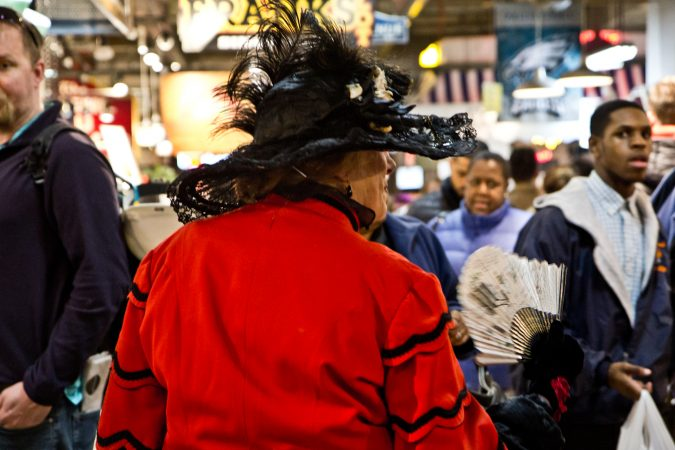 Historical reenactor Nonnie Cyd greets shoppers at Reading Terminal Market's 125th Anniversary Celebration. (Kimberly Paynter/WHYY)