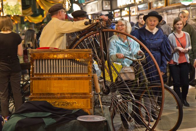The Wheelman Antique Bike Club greets shoppers at Reading Terminal Market's 125th anniversary celebration. (Kimberly Paynter/WHYY)