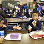 Children at Southwark School eat their school lunches from styrofoam trays, Dec. 20, 2016.