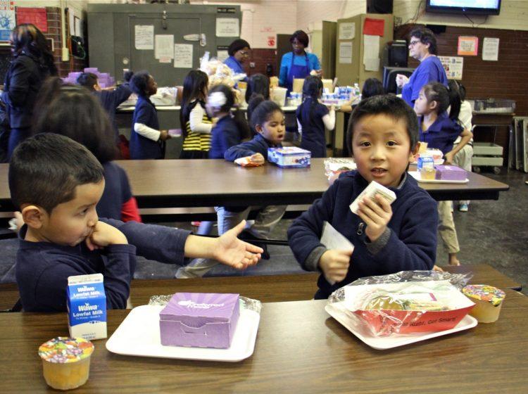 Children at Southwark School eat their school lunches from styrofoam trays, Dec. 20, 2016.