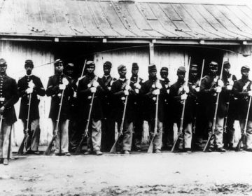 ADVANCE FOR USE SATURDAY, FEB. 6, AND THEREAFTER - FILE - This is an undated 1860's file photo of a military police detachment, known as provost guards, of the 107th U.S. Colored Infantry lined up at Fort Corcoran near Washington, D.C. It's been 150 years since black soldiers from U.S. Colored Infantry units began returning home from their service in the South, where more than 175,000 members fought - and in some cases, died - to free fellow African-Americans from slavery. (AP Photo/Library of Congress, File)