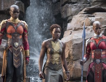 Danai Gurira, Lupita Nyong'o and Florence Kasumba are pictured in a scene from the film, Black Panther. Gurira says the representation of women in Black Panther is important for young girls to see. (Matt Kennedy/Disney/Marvel Studios via AP)