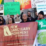 Members of the New Sanctuary Movement protest outside City Hall