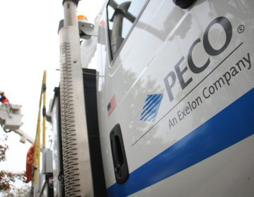 PECO truck in the foreground, PECO worker in the background