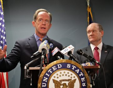 U.S. Senators Pat Toomey and Chris Coons announce their gun legislation in Philadelphia, March 5, 2018. (Emma Lee/WHYY)