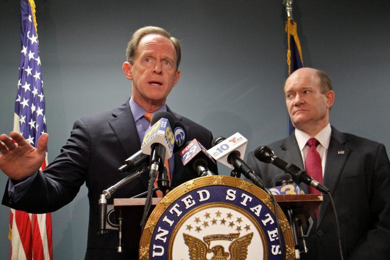 U.S. Senators Pat Toomey and Chris Coons announce their gun legislation in Philadelphia, March 5, 2018. (Emma Lee/WHYY)