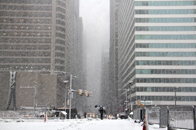 Snow fills the City Hall apron, looking North on Market Street. (Emma Lee/WHYY)