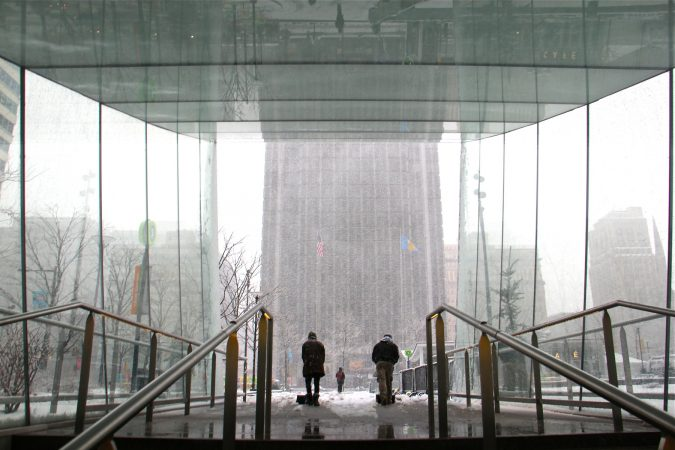 City workers clear the snow from the Dilworth Park subway entrance. (Emma Lee/WHYY)