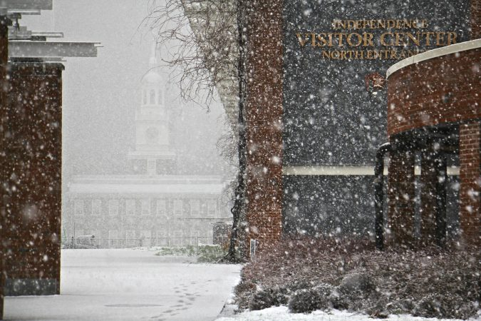 Independence Hall is nearly obscured by heavy snow fall. (Emma Lee/WHYY)
