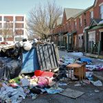 Garbage is piled in front of an apartment complex in Lower Germantown.