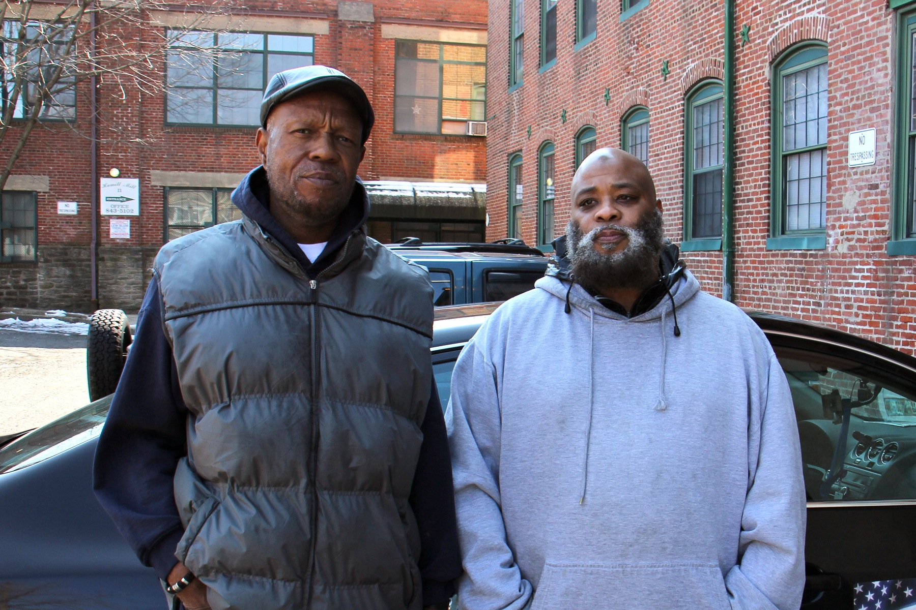 Brothers Tony Pointer (left) and Leroy Prince live in the Hamill Mill II apartments. Prince says he has to heat water on his stove for bathing. (