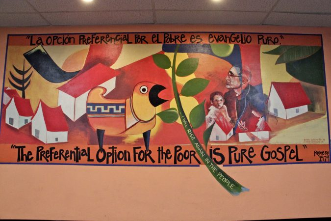 A mural depicting Oscar Romero, by Sister Helen D. Brancato, at the Romero Center in Camden. (Emma Lee/WHYY)