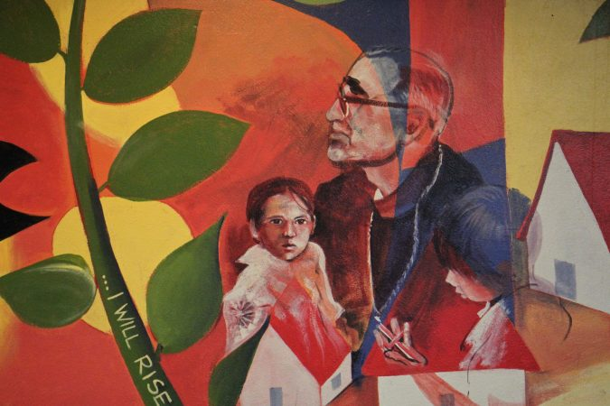 A detail from the mural depicting Oscar Romero at the Romero Center in Camden. (Emma Lee/WHYY)