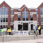 About 20 people turned out for a protest in front of La Salle University's Connelly Library. They object to the decision by the university's board of trustees to sell 46 works of art to pay for educational programs.