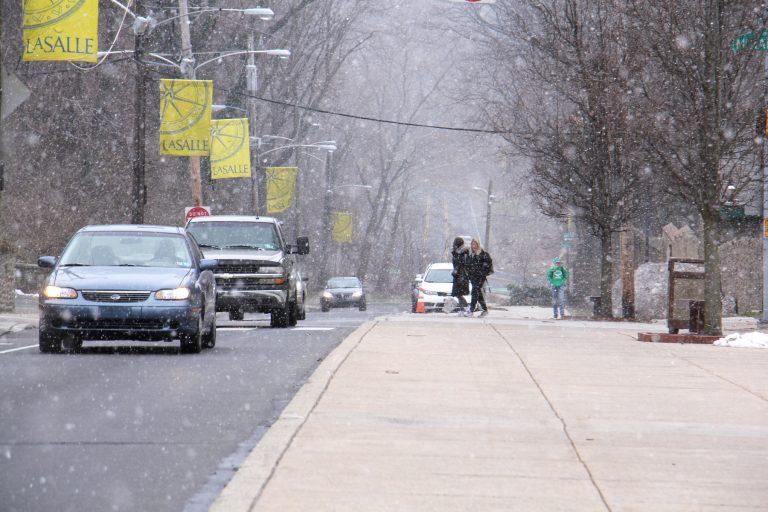Snow falls on the La Salle University campus in Philadelphia. (Emma Lee/WHYY)
