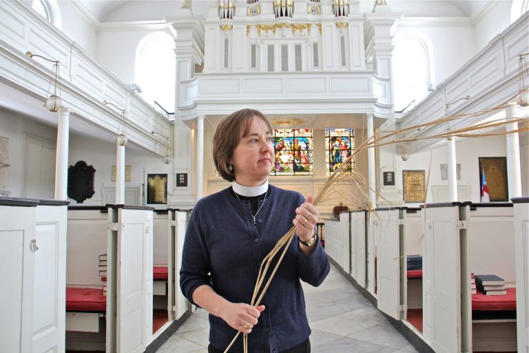 Parishioners at St. Peter's Episcopal Church in Philadelphia will wave locally grown ornamental grasses rather than palm fronds during Palm Sunday services. Rector Claire Nevin-Field holds a sprig of Miscanthus sinensis, an ecologically friendly alternative to the traditional palm.