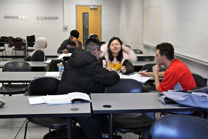 Students split into small discussion groups during an intensive Englisht course for international students at Temple University. (Emma Lee/WHYY)