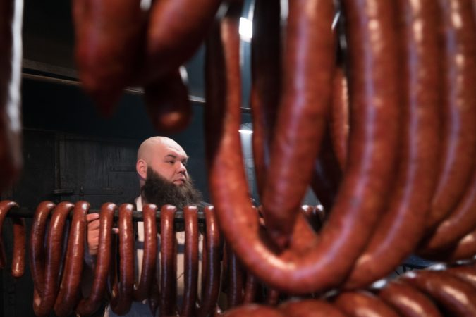 Frank Musser stands just outside the smokehouses at Czerw's Polish Kielbasa in Port Richmond.