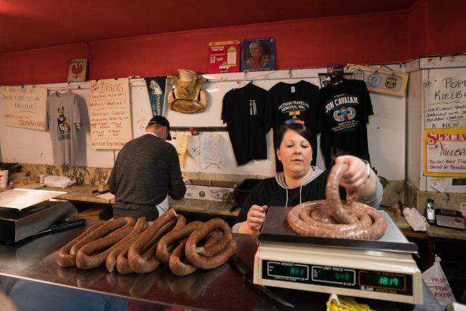 Nicole Crouse weighs out kielbasa on Good Friday at Czerw's Polish Kielbasa in Port Richmond. (Branden Eastwood for WHYY)