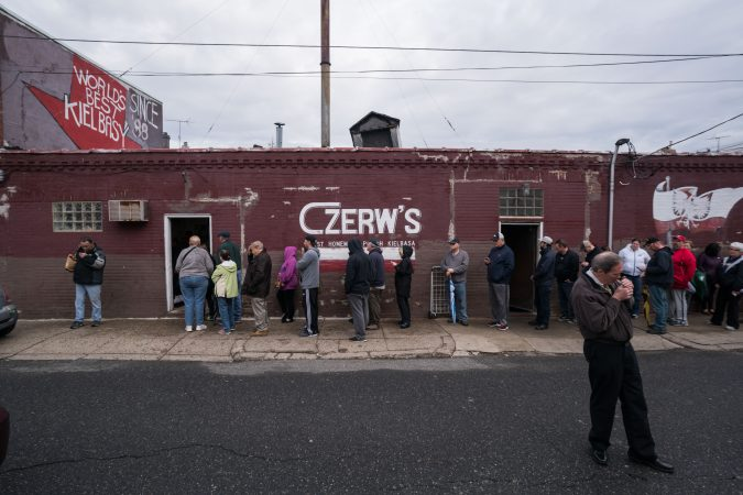 Customers stand outside Czerw's Polish Kielbasa in Port Richmond. (Branden Eastwood for WHYY)