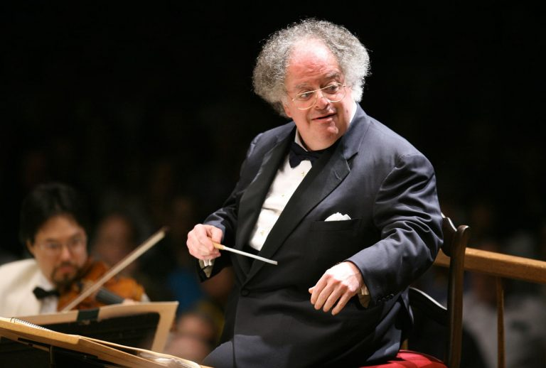 FILE - In this July 7, 2006 file photo, Boston Symphony Orchestra music director James Levine conducts the symphony on its opening night performance at Tanglewood in Lenox, Mass. The Met Opera has fired music director emeritus James Levine, finding