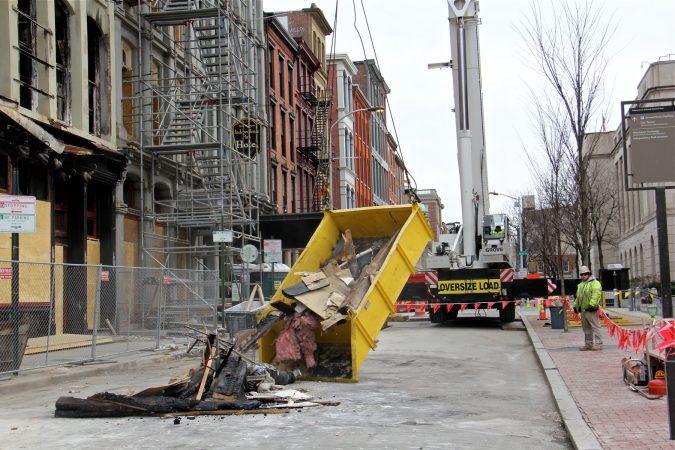A load of debris is dumped onto Chestnut Street. (Emma Lee/WHYY)