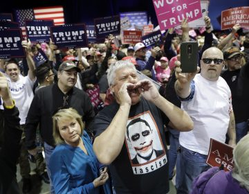 People chant toward the media area before a rally with Republican presidential candidate Donald Trump, Saturday, Nov. 5, 2016, in Reno, Nev. (AP Photo/John Locher)