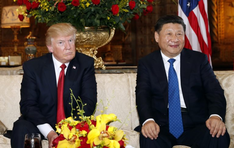 President Donald Trump and Chinese President Xi Jinping, sit as they pose for photographers before a meeting at Mar-a-Lago, Thursday, April 6, 2017, in Palm Beach, Fla.