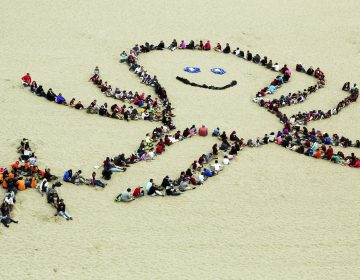 After cleaning up the beach, students create a smiling octopus and other ocean artwork during the 24th annual Kids Ocean Day beach cleanup at Dockweiler State Beach in Los Angeles Thursday, May 25, 2017. Some 4,000 children from Los Angeles-area elementary schools took part, the culmination of a year-round program by the Malibu Foundation for Environmental Education, which seeks to tell children how pollution affects the ocean. (Reed Saxon/AP Photo)