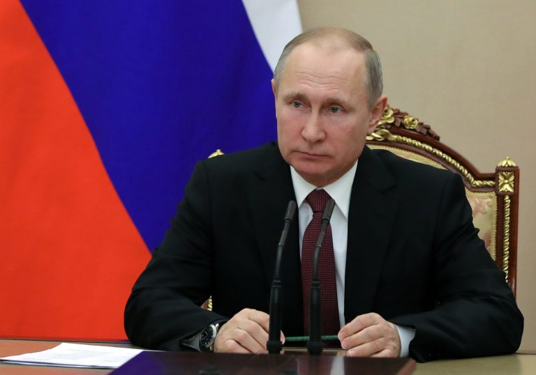 In this Jan. 26, 2018, photo, Russian President Vladimir Putin chairs a Security Council meeting in Moscow, Russia. The State Department has notified Congress that it will not impose new sanctions on Russia at this time. The State Department says it is confident that new legislation enacted last year is significantly deterring Russian defense sales. (Mikhail Klimentyev, Sputnik, Kremlin Pool Photo via AP)