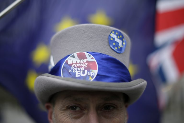 Demonstrators opposing Brexit wave flags as The European Commission's Chief Negotiator for the UK exiting the European Union, Michel Barnier is at 10 Downing Street for a meeting, outside the Houses of Parliament, London, Monday, Feb. 5, 2018. (Tim Ireland/AP Photo)
