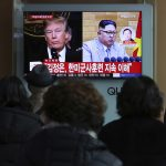 People watch a TV screen showing North Korean leader Kim Jong Un and U.S. President Donald Trump at the Seoul Railway Station in Seoul, South Korea  (Ahn Young-joon/AP Photo)