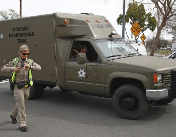 A sheriff's hostage negotiation team passes a California highway patrol checkpoint at the Veterans Home of California in Yountville, Calif., Friday, March 9, 2018. Napa County Fire Capt. Chase Beckman says a gunman has taken hostages at the veterans home. Police closed access to the large veterans home after a man with a gun was reported on the grounds. (Ben Margot/AP Photo)