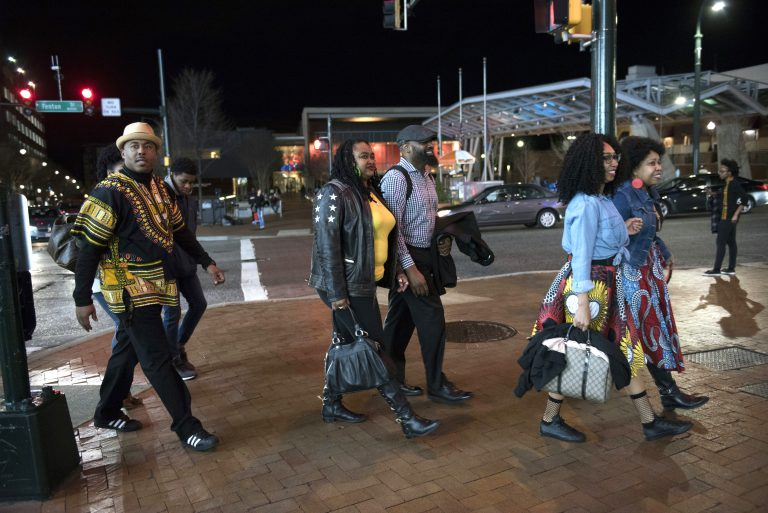In this Feb. 15, 2018, file photo, Emanuel Lawton, (left), and his family dressed in Wakanda-inspired attire arrive to see Black Panther in Silver Spring, Md. Featuring a predominantly black cast, the film that is an ode to Africa - with costuming and sets heavily inspired by African cultures - moved many viewers, including cast members themselves, to dress in African-themed garments for their viewing the film. (Sait Serkan Gurbuz/AP Photo, File)