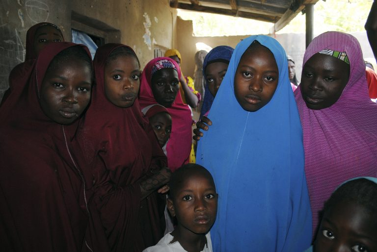 Aishat Alhaji, second, right, one of the kidnapped girls from the Government Girls Science and Technical College Dapchi who was freed, is photographed after her release, in Dapchi, Nigeria, Wednesday March. 21, 2018. Witnesses say Boko Haram militants have returned an unknown number of the 110 girls who were abducted from their Nigeria school a month ago. (Jossy Ola/AP Photo)