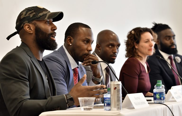 Philadelphia Eagles' Malcolm Jenkins, (left), speaks, as former NFL player Anquan Boldin, New England Patriots' Devin McCourty, moderator New York Times Magazine's Emily Bazelon, and New Orleans Saints' Demario Davis listen during a session to discuss criminal justice issues with other current and former NFL football players at Harvard Law School, Friday, March 23, 2018, in Cambridge, Mass. (Josh Reynolds/AP Photo)
