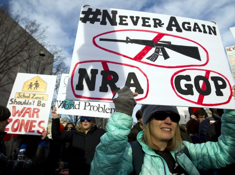 Becky Barger of Cornelius N.C. holds a banner during the