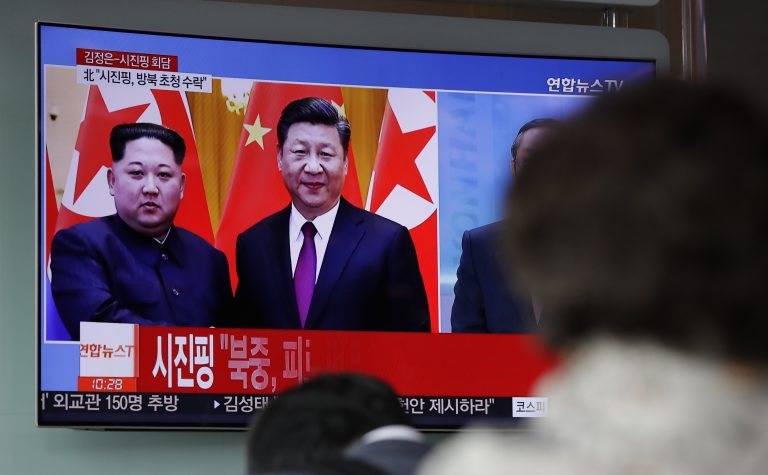 People watch a news program on TV reporting about the meeting between North Korean leader Kim Jong Un and Chinese President Xi Jinping at the Seoul Railway Station in Seoul, South Korea, Wednesday, March 28, 2018. North Korea's leader Kim and his Chinese counterpart Xi sought to portray strong ties between the neighbors and long-time allies despite a recent chill, as both countries on Wednesday confirmed Kim's secret trip to Beijing this week. (Lee Jin-man/AP Photo)