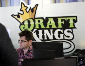 In this Thursday, Jan. 11, 2018, file photo, employees work at the DraftKings office in Boston. The explosion in popularity of daily fantasy sports over the last decade has created a generation of sports fans more attuned to gauging individual player statistics than how two teams may fare against each other, the challenge at the heart of traditional sports wagering. (Charles Krupa/AP Photo, file)
